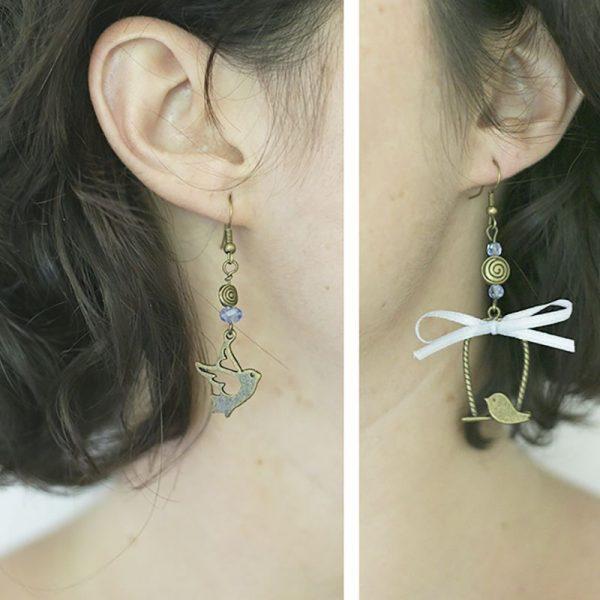 Boucles d'oreilles couple d'oiseaux bronze dépareillées par Divine et Féminine.