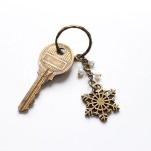 Porte clefs neige flocon bronze par Divine et Féminine.