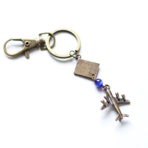 Porte clefs voyage en laiton bronze par Divine et Féminine.