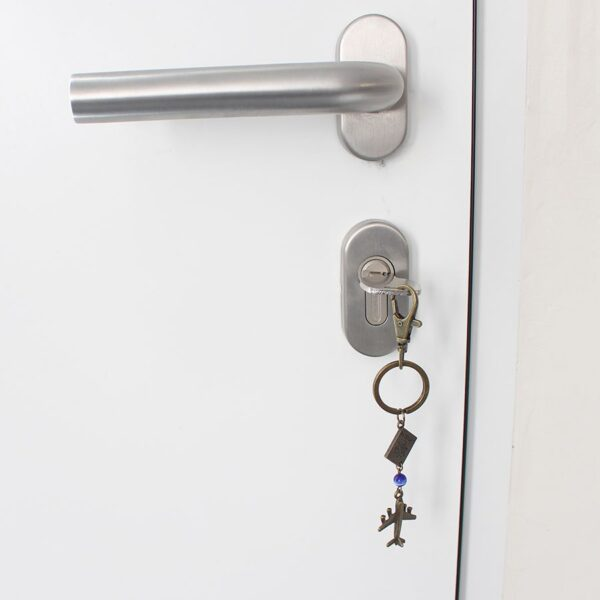 Porte clefs voyage autour du monde par Divine et Féminine.