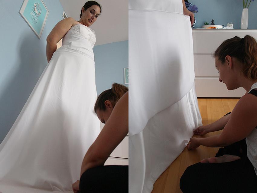 Trait d'union création, robe de mariée sur mesure : étape de finition avec l'ourlet.