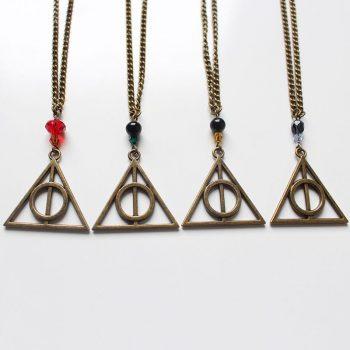 Colliers fantaisie bronze reliques de la mort Harry Potter par Divine et Féminine.
